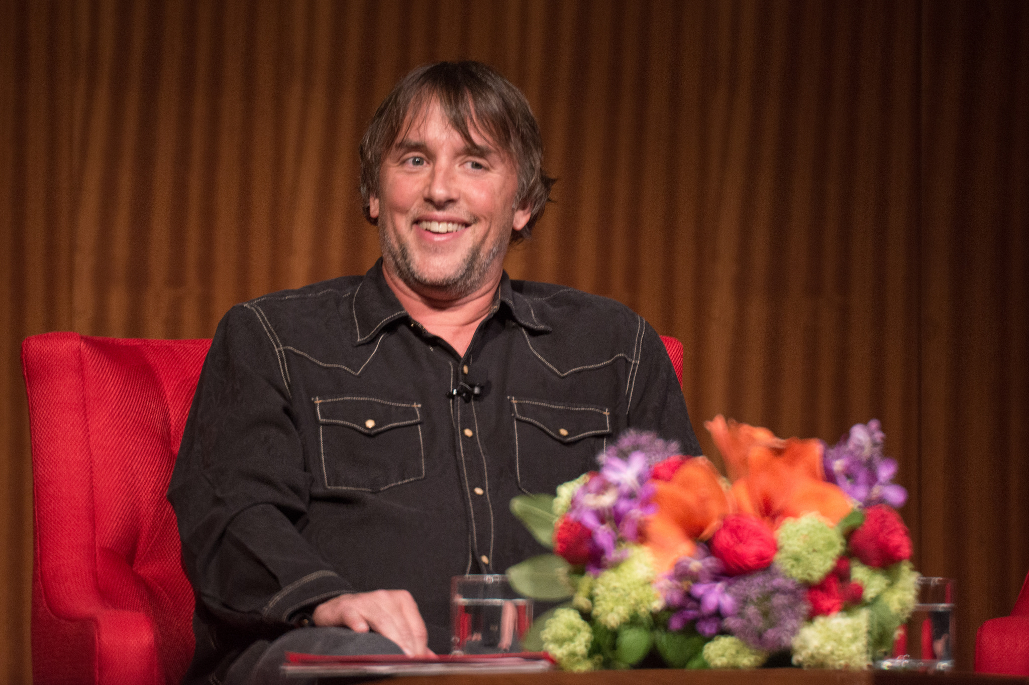 "Director Richard Linklater and actor Ellar Coltrane shared their experiences in the making of the groundbreaking film, ""Boyhood"", with Friends of the LBJ Library members at the LBJ Presidential Library on April 27, 2015. The program was moderated by LBJ Library Director Mark Updegrove and welcomed by Jim Ritts, Executive Director of the Paramount Theatre. Photographer Matt Lankes signed copies of his book, ""Boyhood: Twelve Years on Film,"" before the program with Linklater and producer Cathleen Sutherland. Photo by Lauren Gerson."